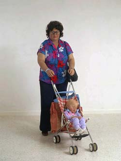Woman with Child in a Stroller